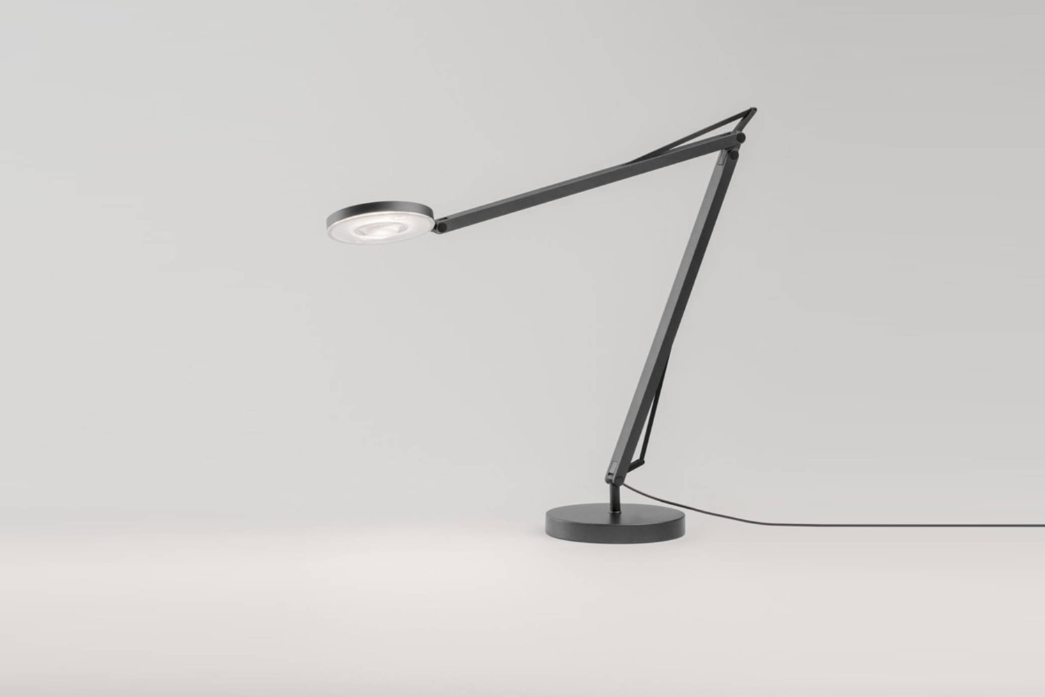 At Plug Lighting the John Desk Lamp is especially slender and designed with an LED light. Contact Plug Lighting for ordering information.