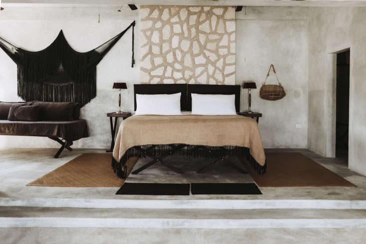 a neutral bedroom with hints of muted gold. 9