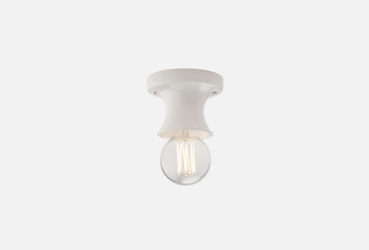 thealabax small surface ceiling fixture is available in white (shown), black, 14