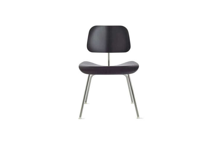 theeames molded plywood dining chair in black stain with metal legs; \$695 at 19