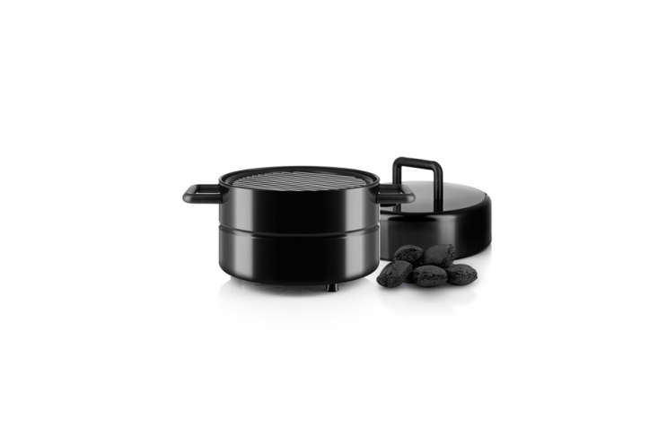 TheEva Solo To Go Grillis compact and each element stacks on one another and fastens with a polyester band around the entire unit; €0 ($6 USD) at Connox.