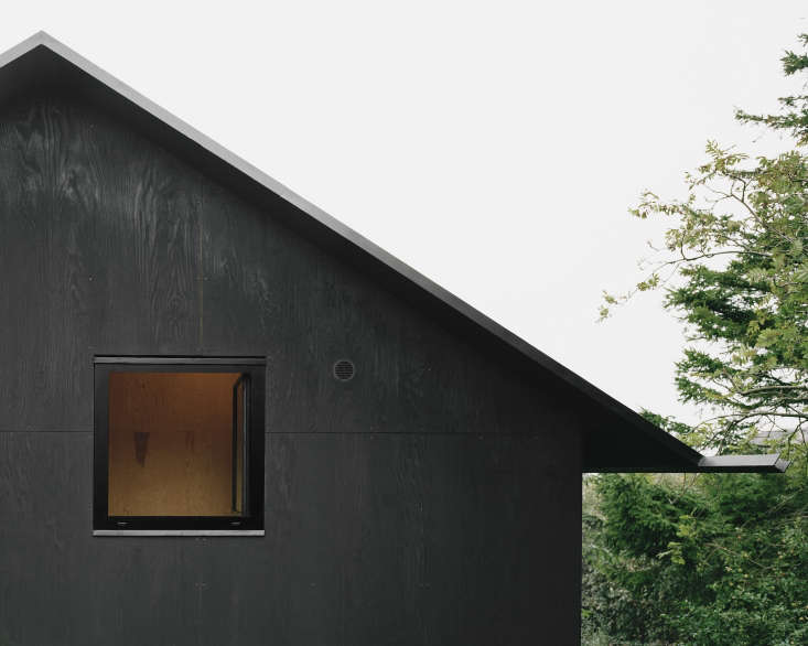 the roof is coated in simple tar paper and the thin plywood eaves feature integ 9