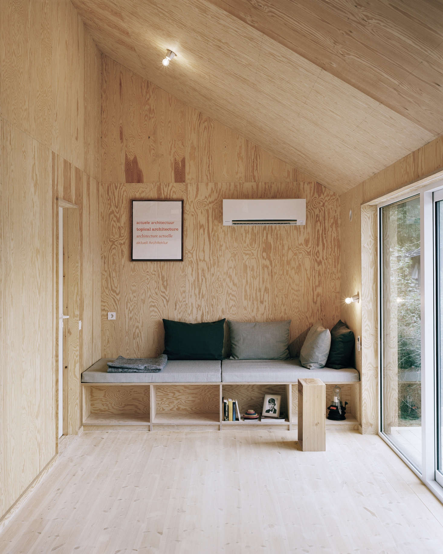 Plywood panels of various types and grains line the sitting room inArchitect Visit: Johannes Norlander in Sweden.