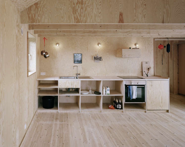 A kitchen clad entirely in plywood by Johannes Norlander Arkitektur. For more of the all-plywood interior, see Architect Visit: Johannes Norlander in Sweden.