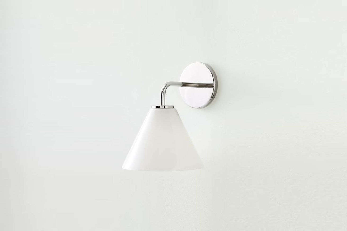 West Elm seems to always have a classic-looking wall sconce available. Their latest is the Sculptural Glass Cone Sconce in Milk with four choices of hardware finishes; $79.