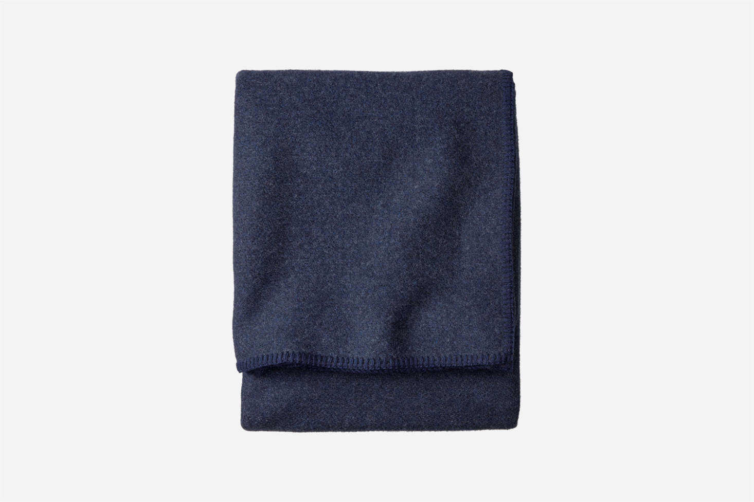 The Pendleton Eco Wise Wool Solid Blanket, shown in Navy Heather, is $