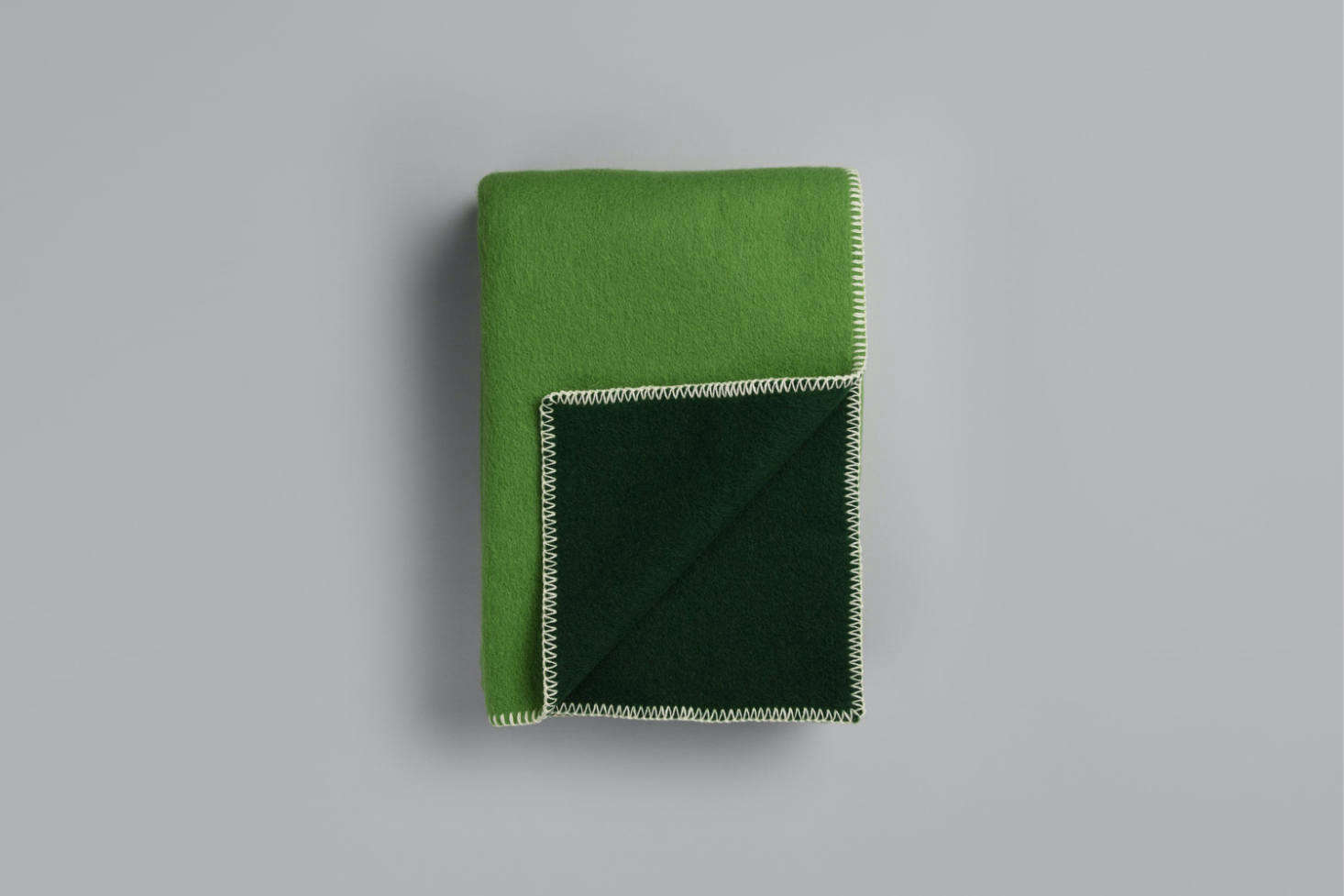 The two-toned Stemor Blanket designed by Kristine Five Melvær for Roros Tweed is $0 at Fjørn Scandinavian.