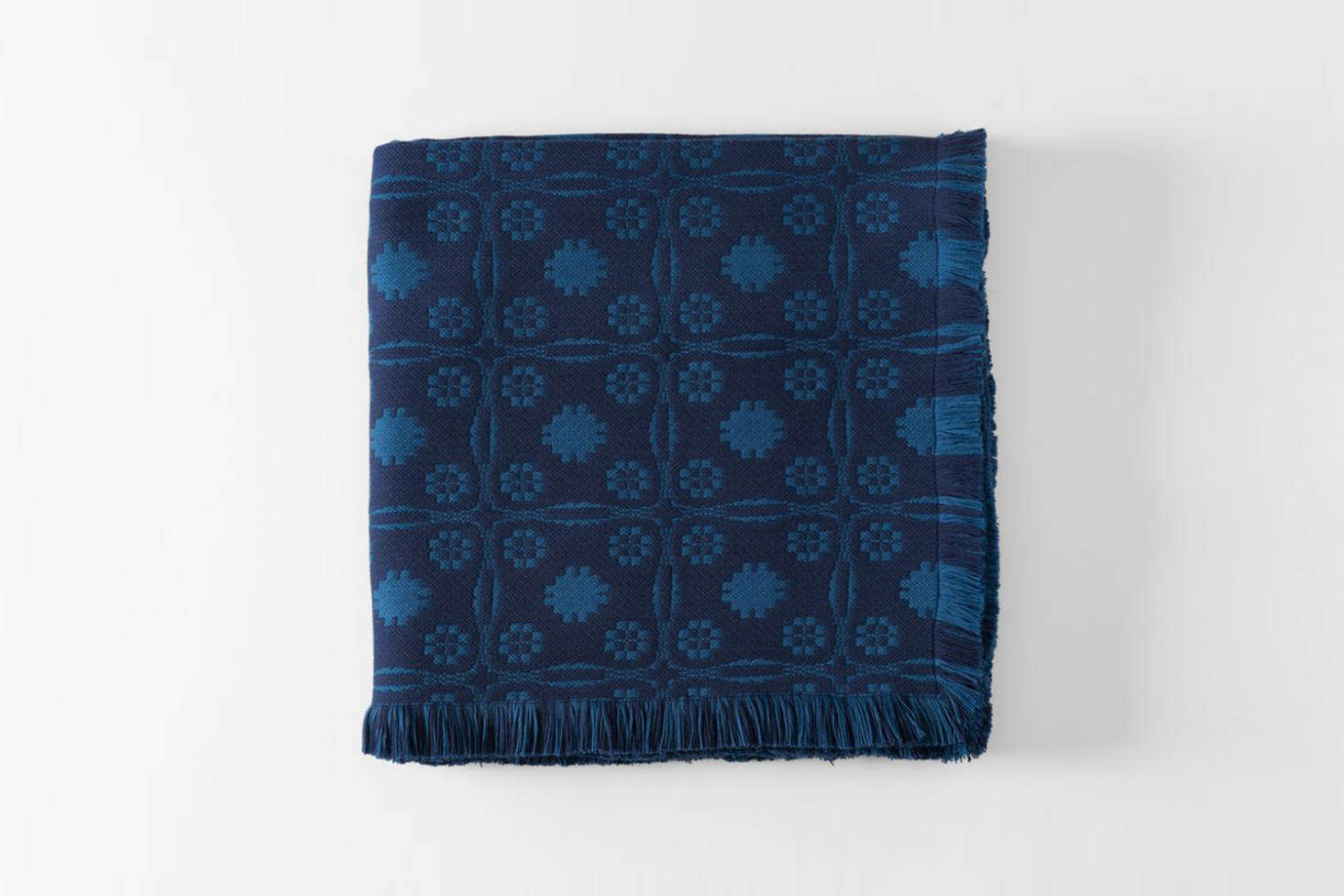 Stealth luxury: The MARCH Indigo Sturbridge Blanket from RP Miller is a weighty wool blanket woven in Guatemala from soft Merino wool; $src=