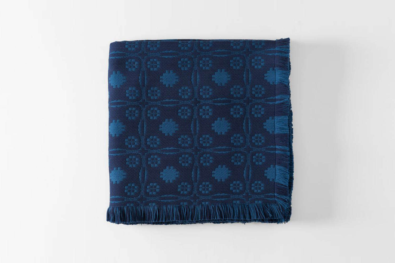 Stealth luxury: The MARCH Indigo Sturbridge Blanket from RP Miller is a weighty wool blanket woven in Guatemala from soft Merino wool; $loading=