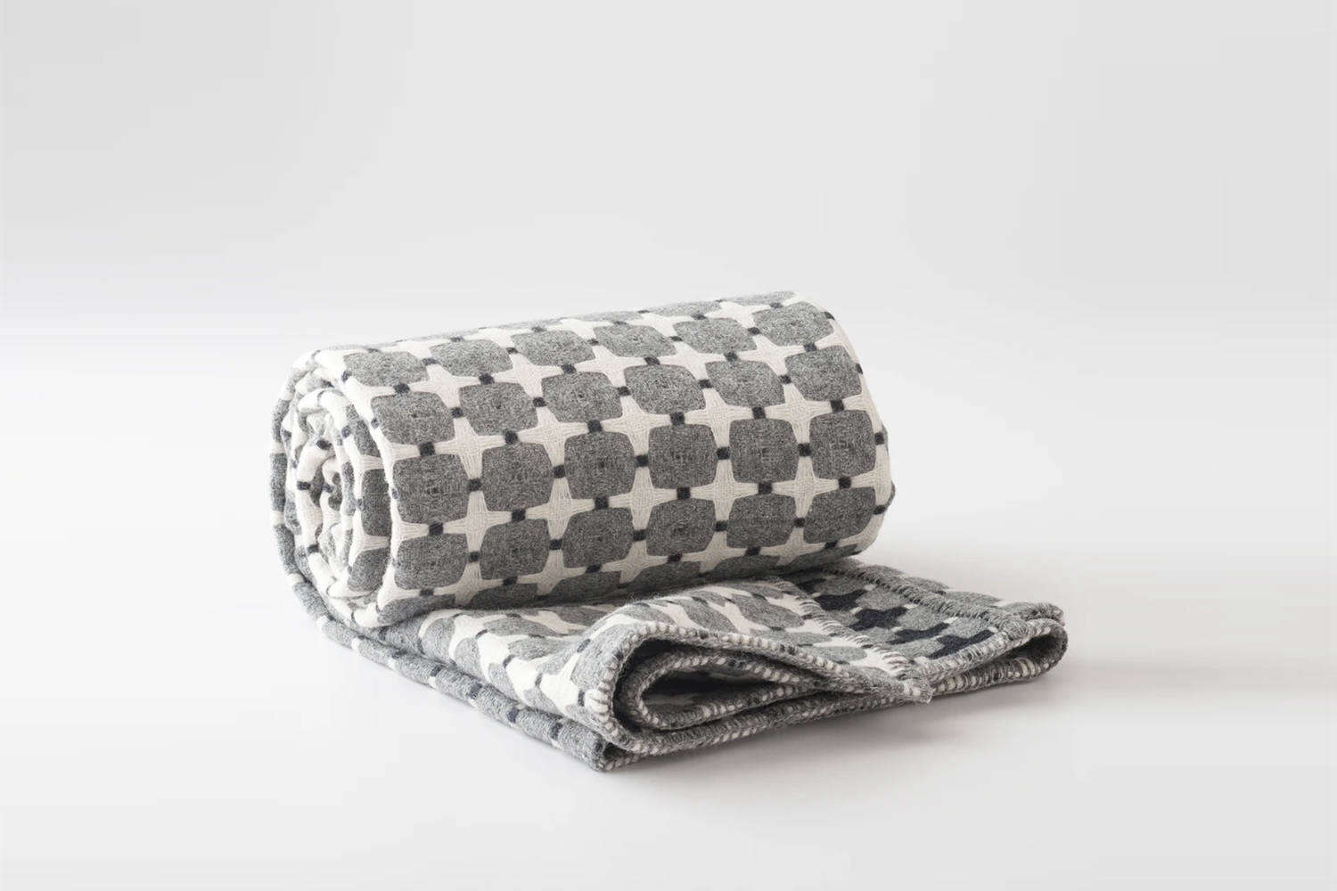 Designed by British weaver Eleanor Pritchard and woven in a Welsh mill, the Eleanor Pritchard Wool Throw is designed in a fully reversible pattern; $349 at Schoolhouse.