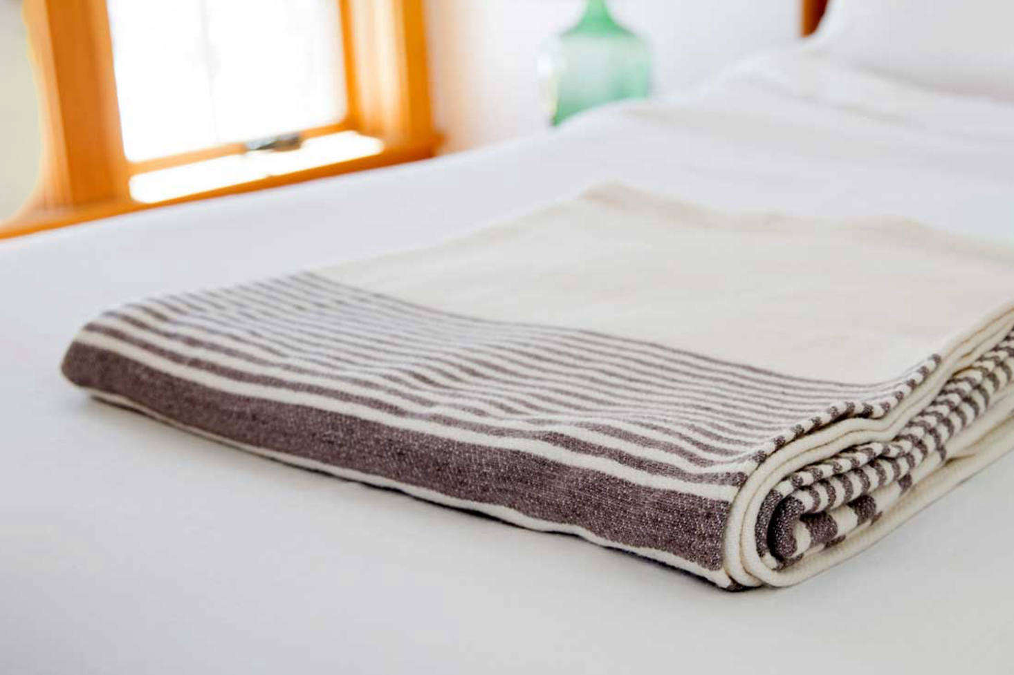 Washable wool winter blankets from Swans Island in Maine are made of a two-layer winter weave of wool from Penobscot Bay sheep and dyed by hand using all-natural dyes. The Penobscot Wool Blanket, shown here, is $495-$675.