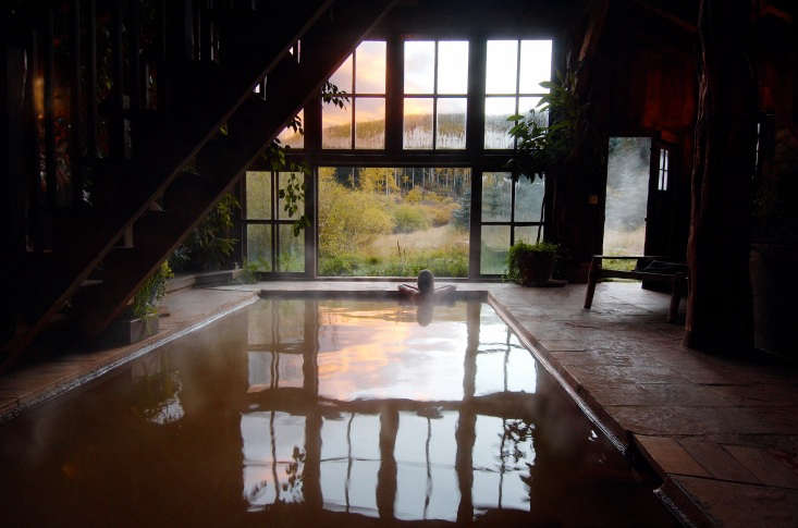 The bathhouse interior features a large pool.