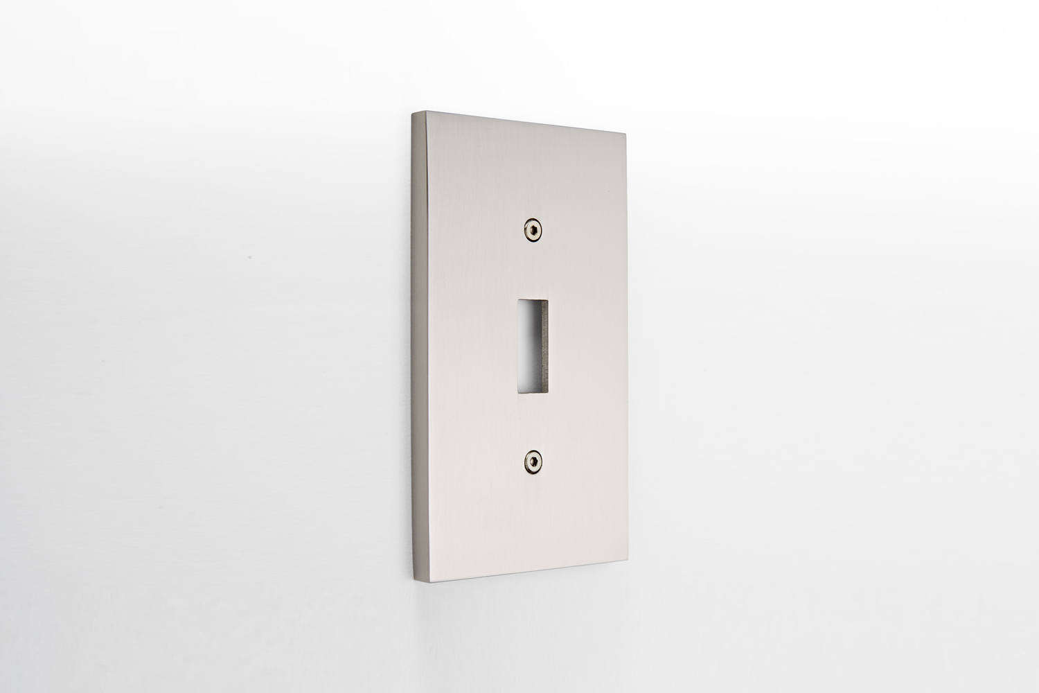 The Fenton Single Toggle Switchplate, shown in Brushed Nickel, is $ at Rejuvenation.