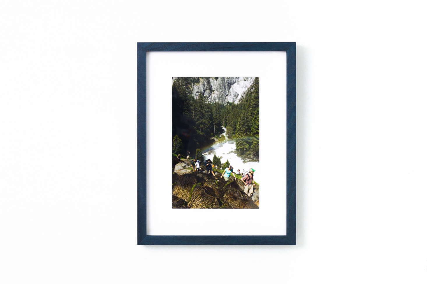 The Indigo Walnut Gallery Frame is a wood frame finished in deep blue; prices range depending on the article framed within available from Framebridge.