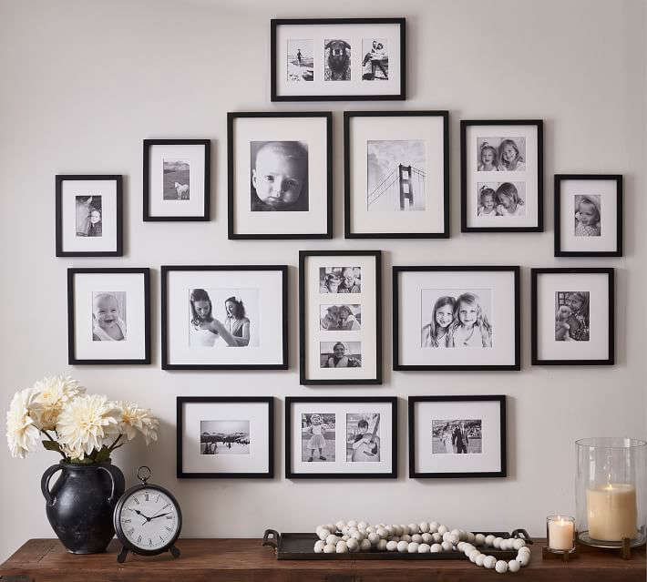 The Wood Gallery Frames in a Box is a set of  frames in Black, Espresso, Modern White, Graywash; $449.50 at Pottery Barn.
