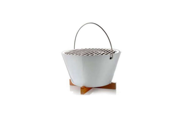 The compact Eva SoloTable Grillfrom Danish designers Claus Jensen and Henrik Holbaek is ideal for urban outdoor spaces. The wooden base protects your outdoor table from the heat; after grilling, the bowl, rack, and insert can be put in the dishwasher for easy cleanup; $9 at Amazon.