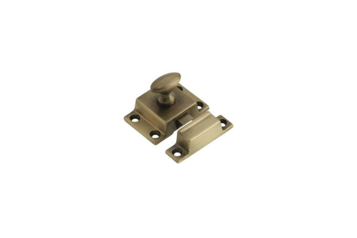 The Small Cast Brass Cupboard Latch in an Antique-by-Hand finish is a hand-finished reproduction style from House of Antique Hardware for $.79 each.