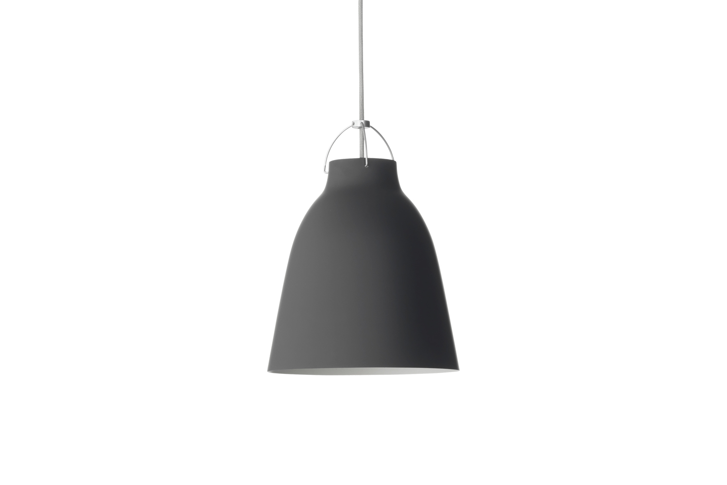 A longtime Remodelista favorite, the oversized Caravaggio Pendant Lamp designed by Cecile Manz is available in both glossy and matte black (shown); $5-$loading=