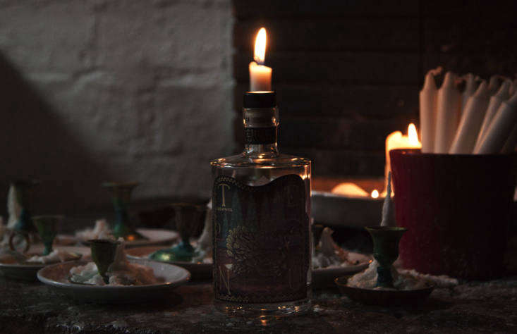 Spent candles. Also on the tables:chrysanthemums, artfully past their peak, in reused wine bottles.Photograph via Antto Melasniemi.