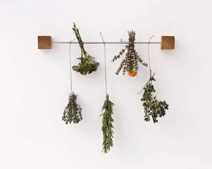 We like this artful herb rack, discovered on Etsy, for displaying cut herbs. Read on inA Clever Kitchen Herb Rack from Austria.