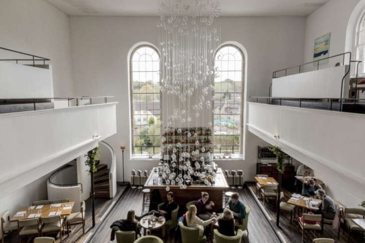 the double height dining room is illuminated by a cascading glass fiber optic c 9