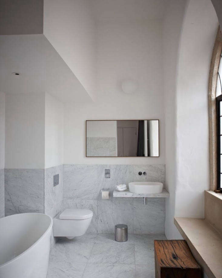 spartan, marble tiled baths.photograph courtesy of at the chapel. 14