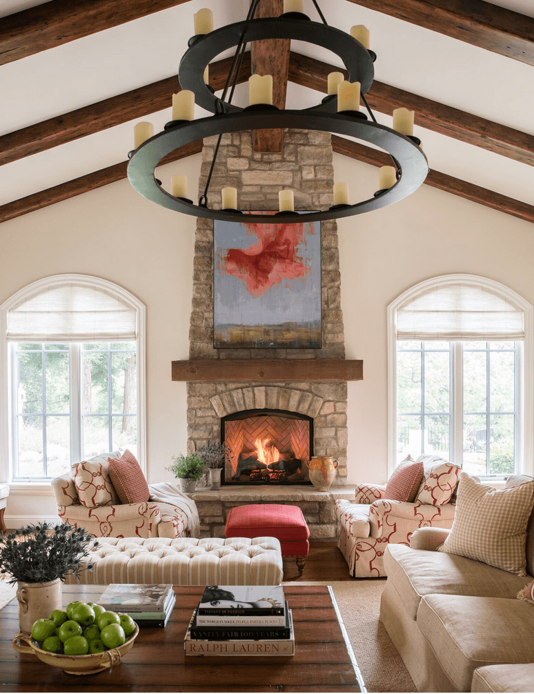 Great room with vaulted ceilings, pendant lighting, stone fireplace and upholstered sofas. Photography by Thomas Kuoh