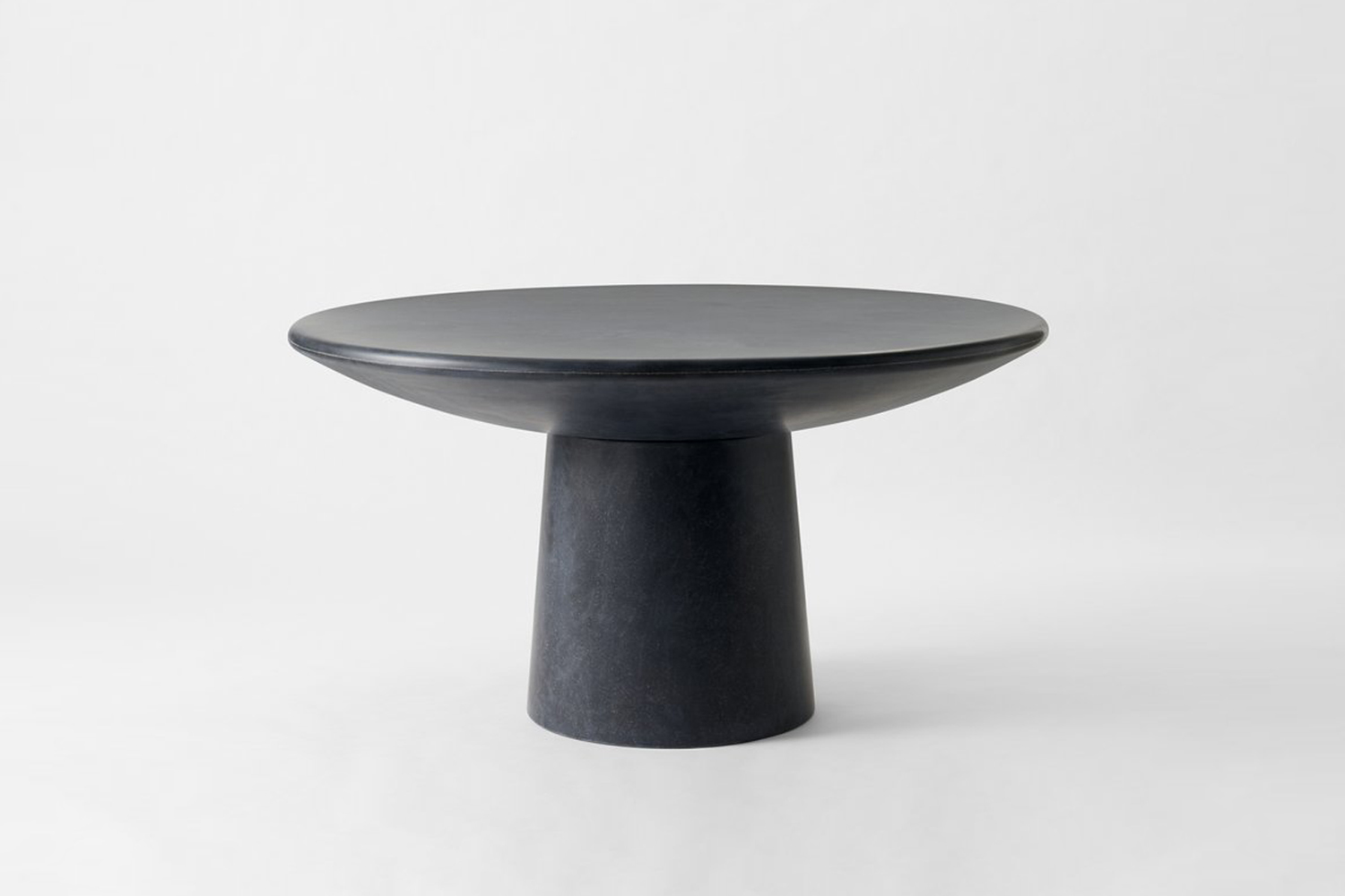 The Faye Toogood Charcoal Roly Poly Dining Table is $,000 at March.