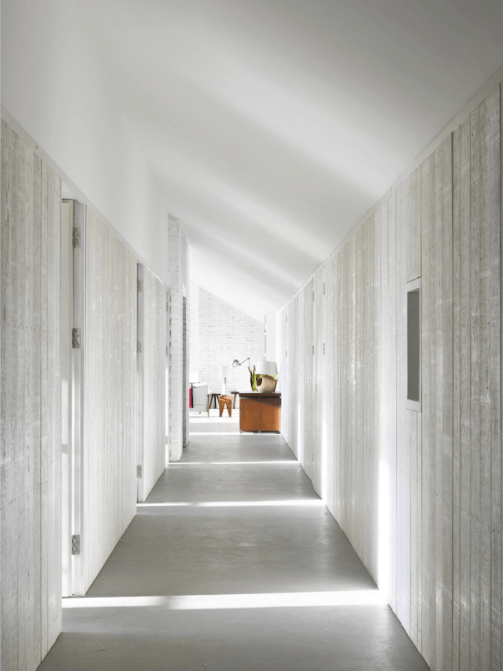 A Stable Reborn in Rural Norfolk Light floods the long concrete and wood paneled hallway.