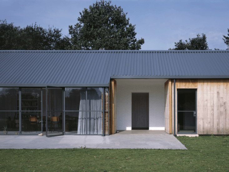 A Stable Reborn in Rural Norfolk The doors open onto an enclosed entryway.