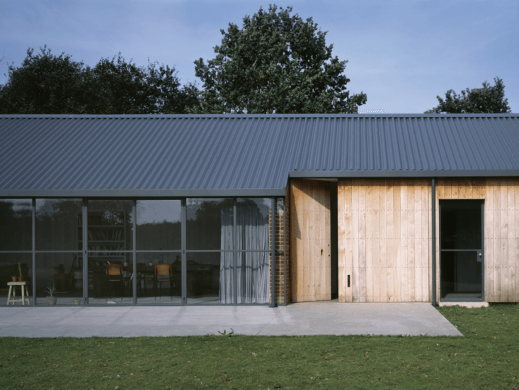 A Stable Reborn in Rural Norfolk Heavy oak stable doors can be closed during colder weather.