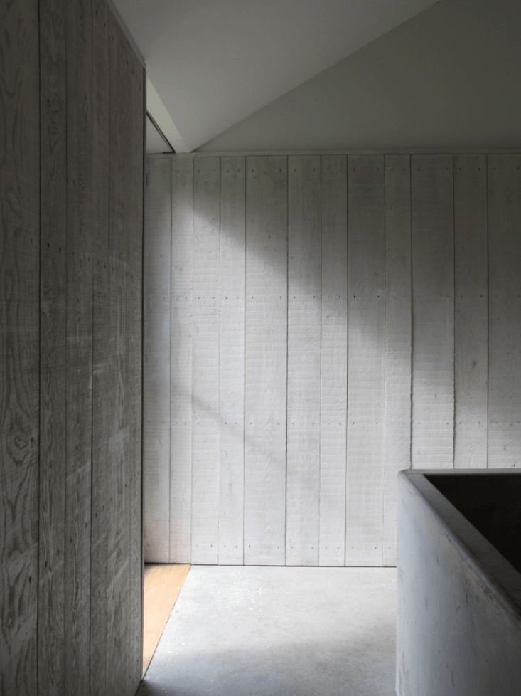 A Stable Reborn in Rural Norfolk Whitewashed wood paneling is used throughout the house.
