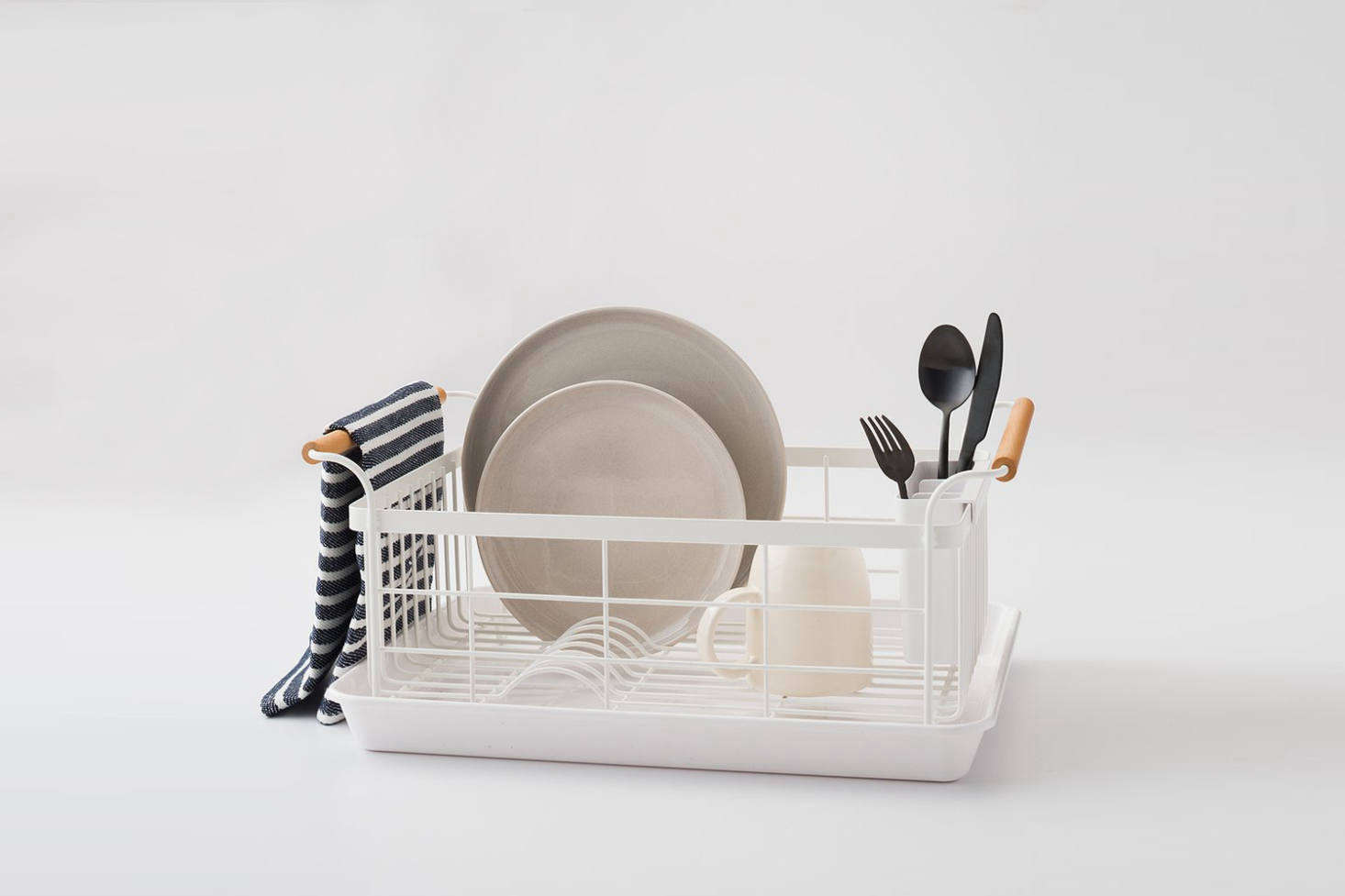 The Yamazaki Wood Handled Dish Drainer is made of powder coated steel and walnut handles; $68 at Schoolhouse. For more on Yamazaki see Genius Low-Cost Storage Solutions from Japan.