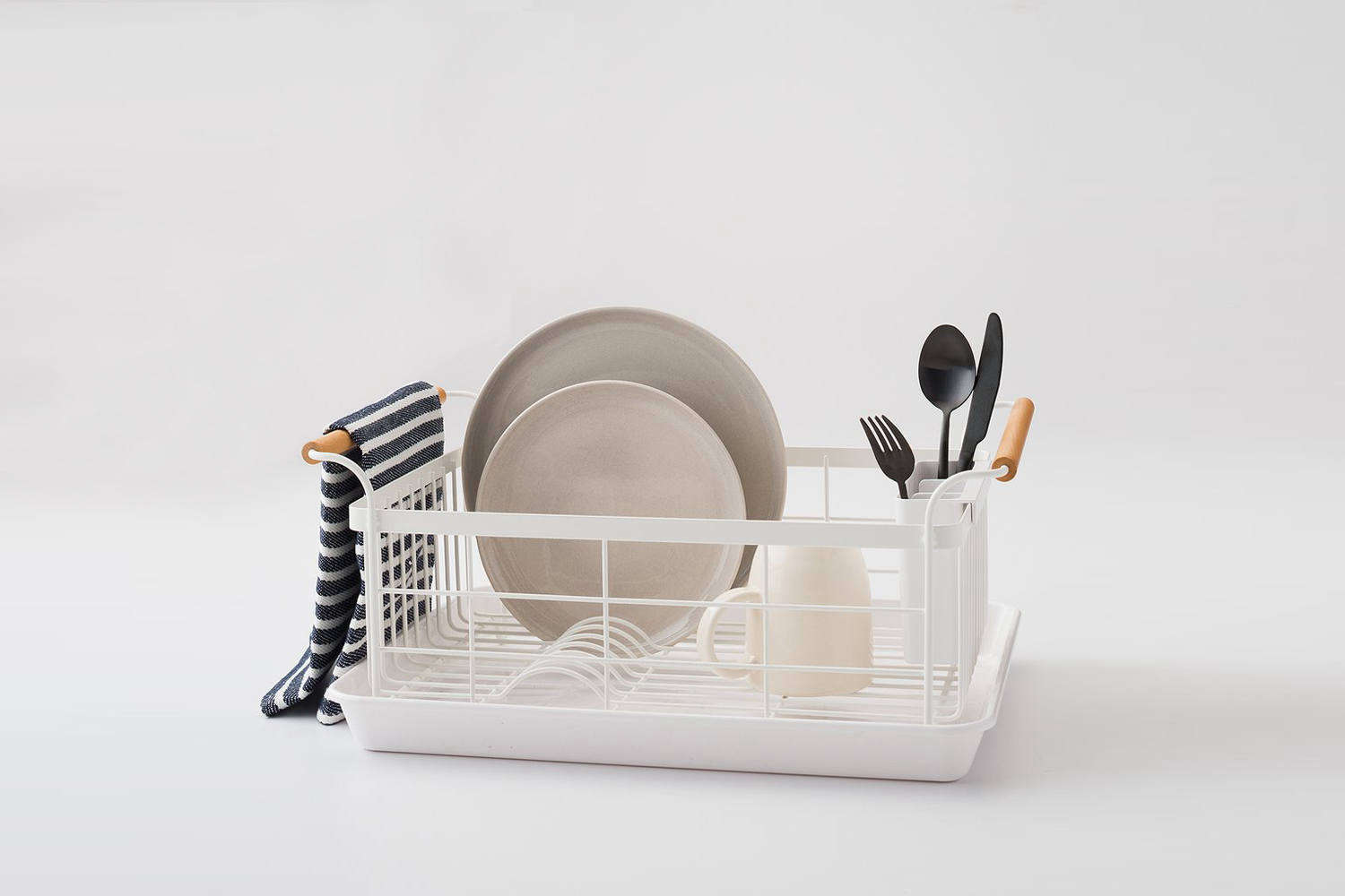 The Yamazaki Wood Handled Dish Drainer is made of powder coated steel and walnut handles; $68 at Schoolhouse. For more on Yamazaki seeGenius Low-Cost Storage Solutions from Japan.