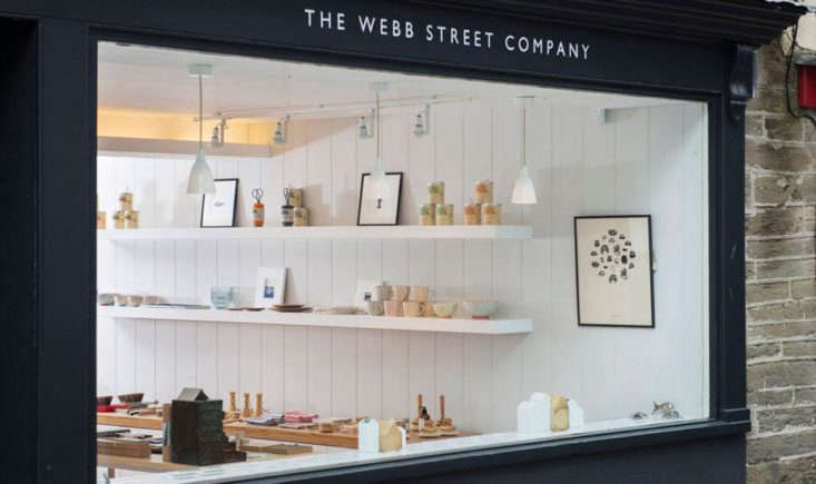 a peek into the shop from its handsome charcoal exterior; a row of porcelain he 9