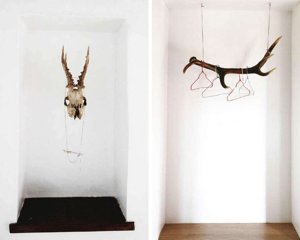 A skull and antlers serve as accessories and clothing racks.