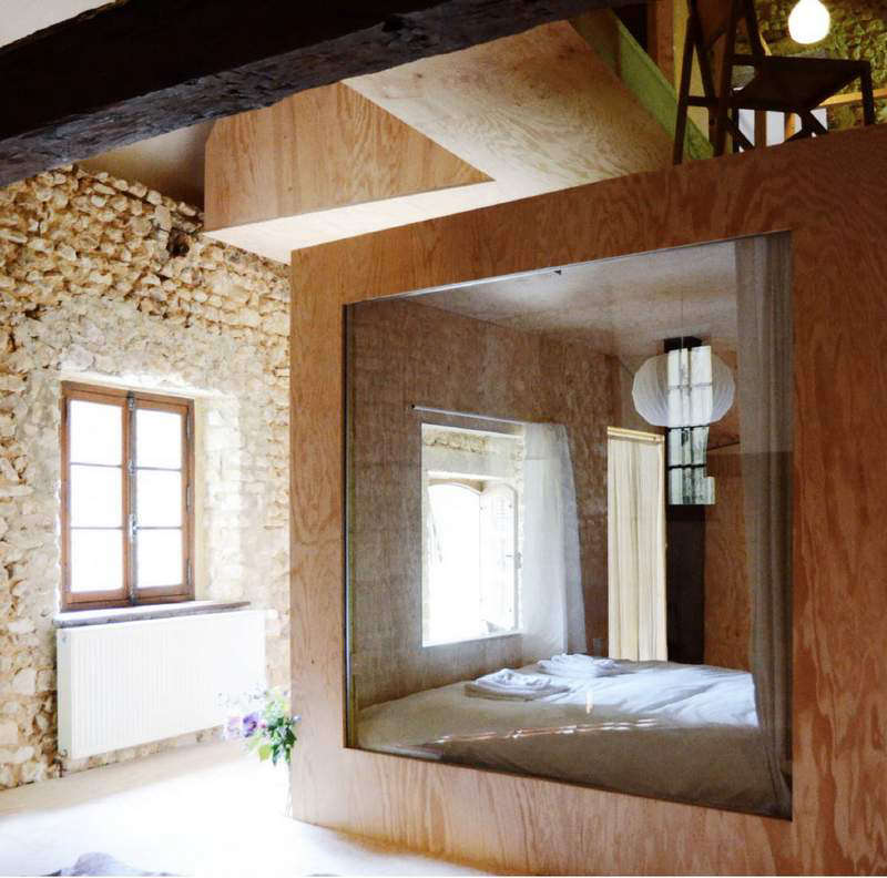 A plywood buildout separates one bedroom from the other.