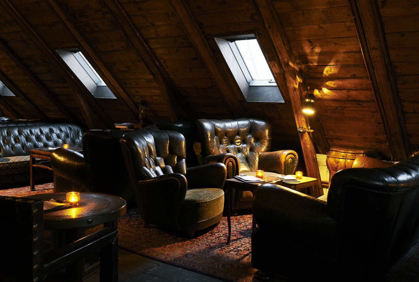 Inviting leather armchairs in the upstairs attic bar.
