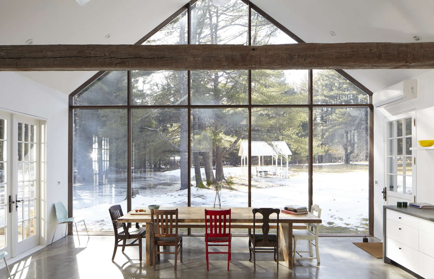 The kitchen resides in a modern addition that echoes the roofline of the original house. The