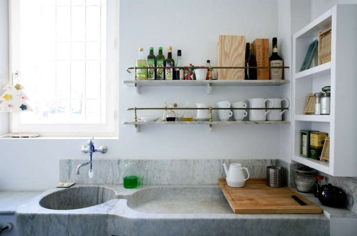 A vintage marble sink and counter in an Italian country house; photograph from La Dolce Vita: A Restored th-Century Convent Outside Milan.