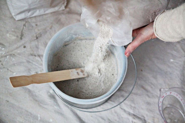 mixing limewash fromdiy project: limewashed walls for modern times. 16