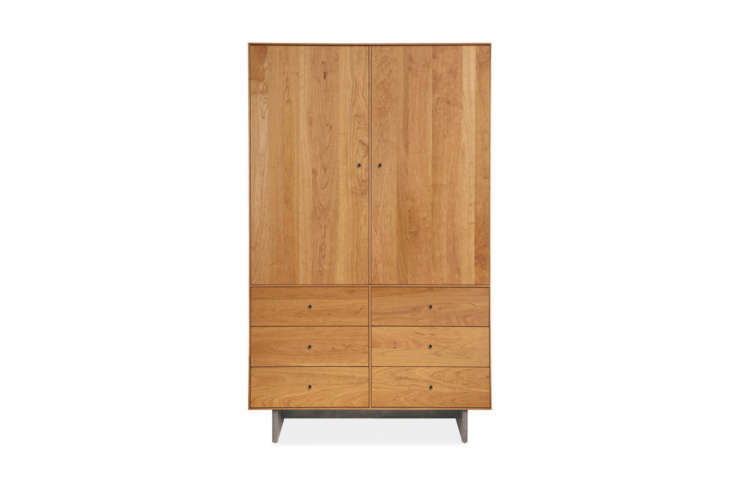 The Room & Board Hudson Armoire with Wood Base, shown in Cherry, is $