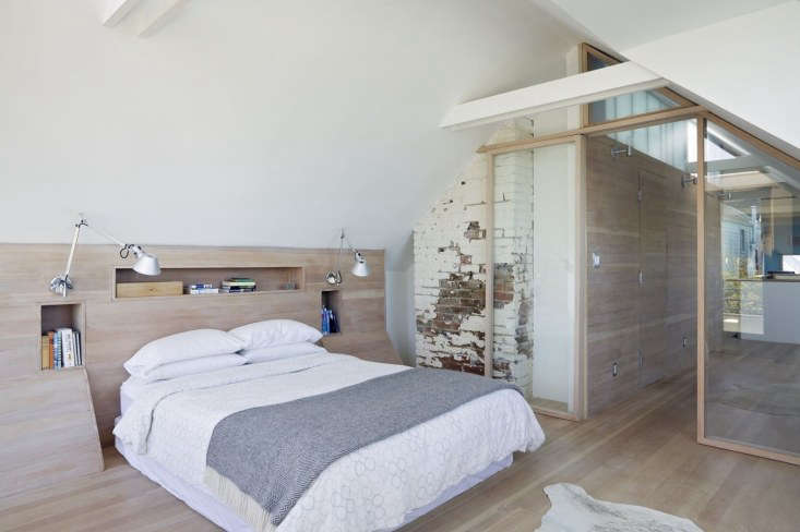 In a remodel of a Victorian house in San Francisco, architects Mork Ulnes commissioned furniture designerYvonne Mouser to design aningenious wood headboard thatincorporates built-in storage while also providing structural reinforcement. See the complete remodel in The Architect Is In: Saving the Hippie Soul of a Victorian House.