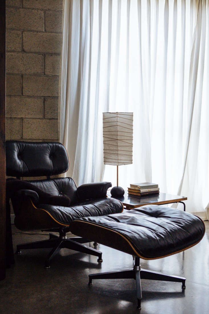 A vintage Eames Lounge Chair and Ottoman in the corner of Joan McNamara&#8