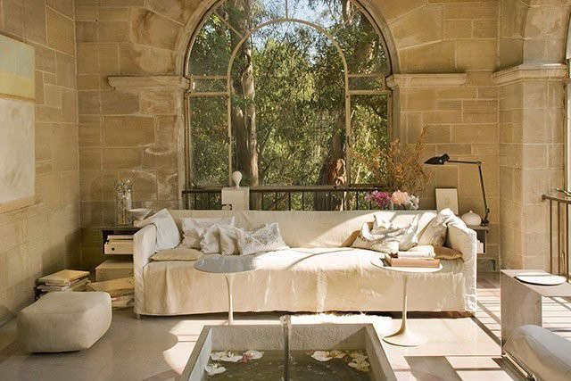 Doheny Estate | Solarium: Washed leather and linen sofas with detailed side pocket zippers (handcrafted by jewelry designer), laser cut pillows, custom steel sofa, back table Photo: Mary E Nichols