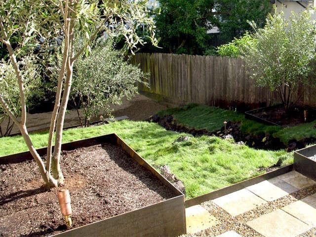 metal hillside: this garden mixes classic rock walls with sqaure metal planters 16