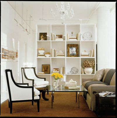 White Loft Traditional Study: A tall custom book case defines this cozy space for a tete-a-tete.