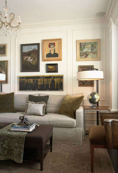 Old World Apartment Traditional Study: The clients collection of paintings adds interest and personalizes this study.