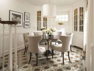 Cape Cod Traditional Dining Room: The floor of this Cape Cod style dining room, with built in corner cabinets, features a custom painted design in place of a rug for a traditional yet modern feel.