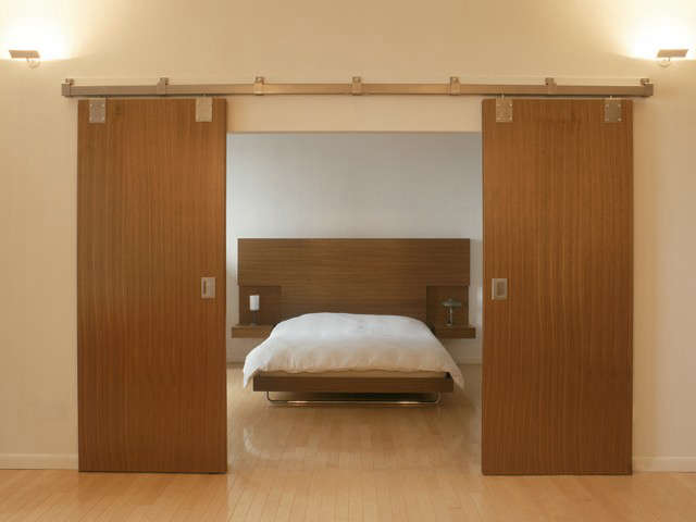 barn doors reveal a bed for the barlow lawson apartment: click here for more in 68